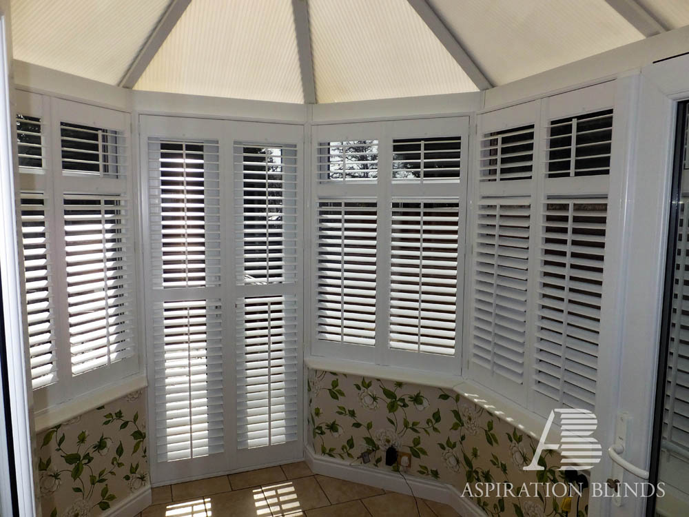 Conservatory style plantation window shutters by Are plantation shutters still in style 2017